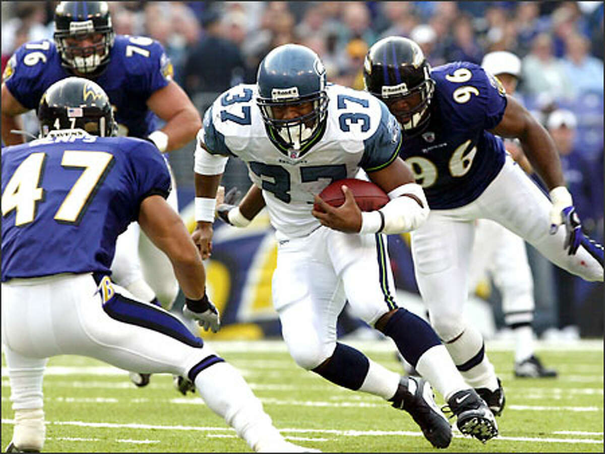 Seahawks running back Shawn Alexander rushes for 6 of his 72 yards on 22 carries against the Ravens.