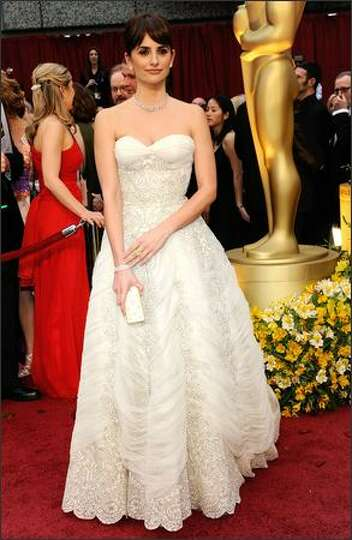 AP: Penelope Cruz wore a white 1950s Balmain gown, with a strapless neckline and hand-embroidery wit