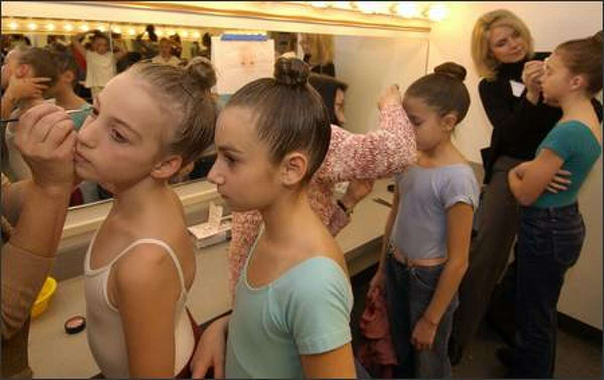 Parent volunteers -- 160 of them -- are in charge of applying makeup to the young performers, most of whom are girls. In all, 222 children, divided into three casts, will perform in
