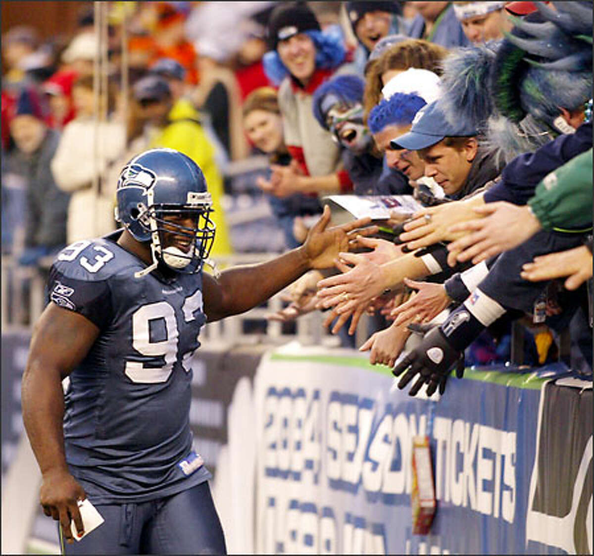 Tackle John Randle greets the fans after a dominating performance by the defense.