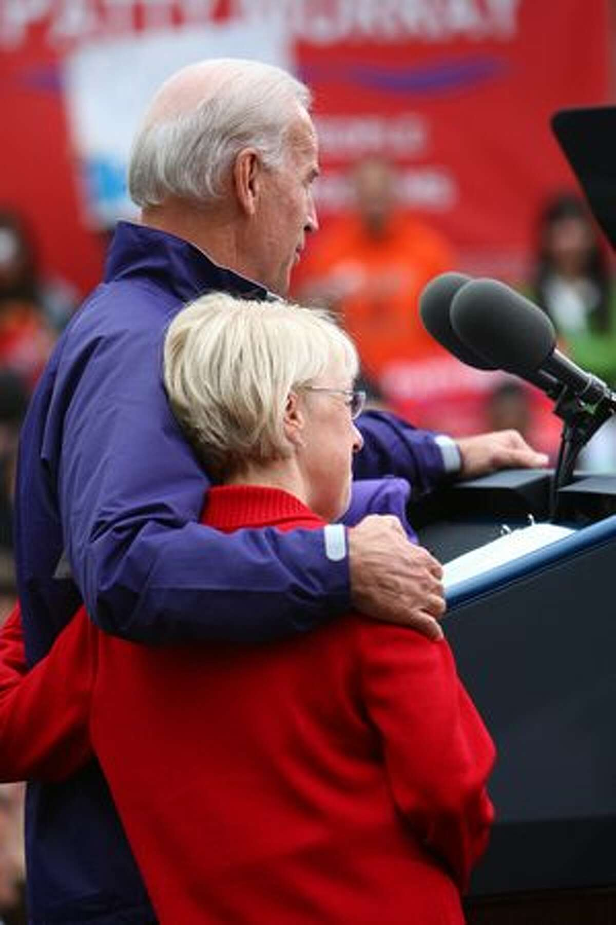 Vice President Joe Biden embraces U.S. Senator Patty Murray in front of a crowd of supporters on Friday.