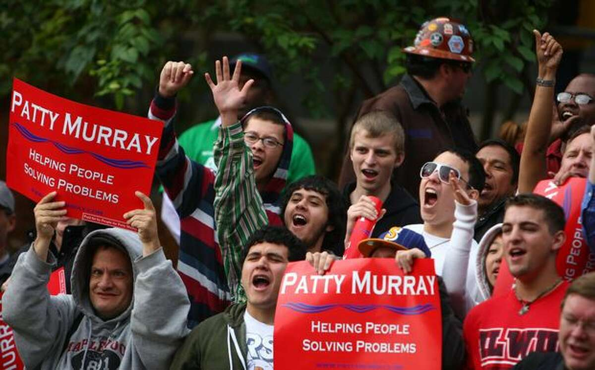 Supporters of Vice President Joe Biden and U.S. Senator Patty Murray cheer during introductions on Friday at the University of Washington Tacoma. Biden is in town to support Murray, who is running against former gubernatorial candidate Dino Rossi for Senate.