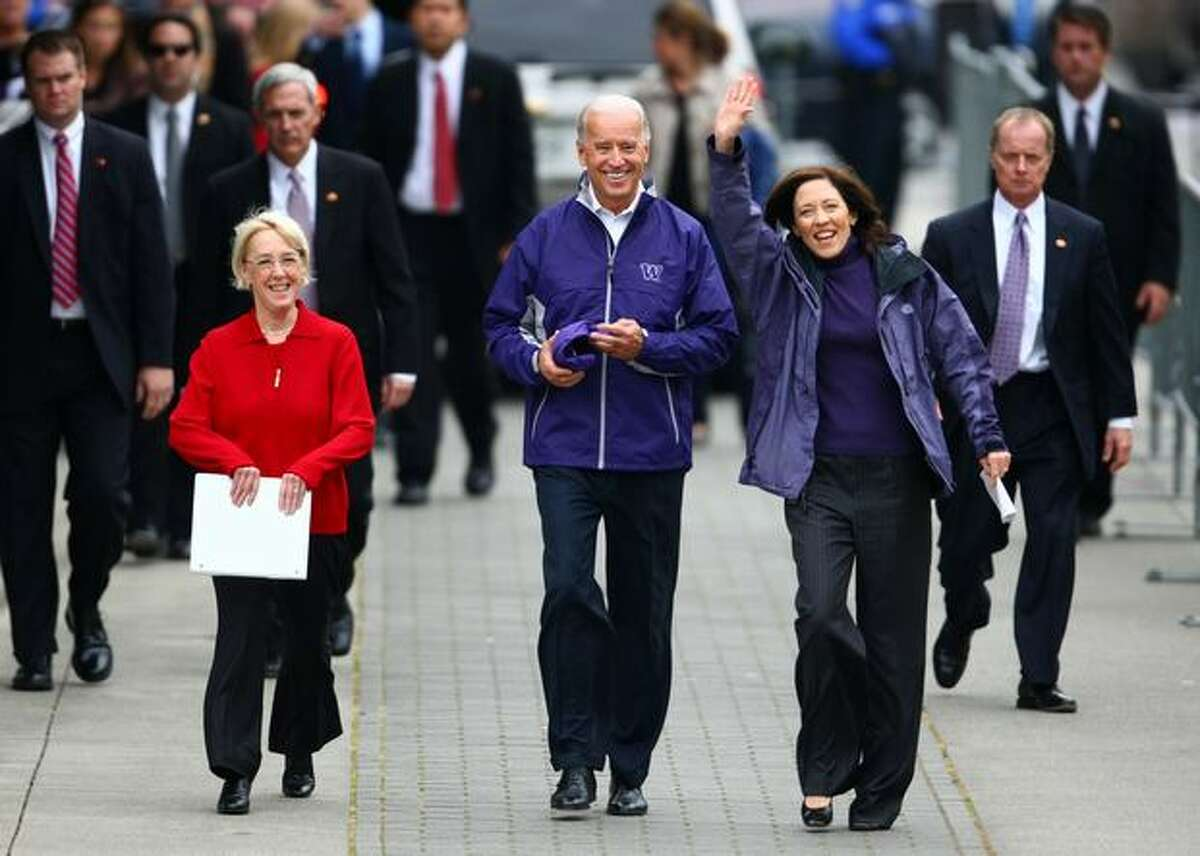 U.S. Senator Patty Murray, left, and Maria Cantwell walk with U.S. Vice President Joe Biden toward a crowd of supporters on Friday at the University of Washington Tacoma. Biden was in town to support Murray.