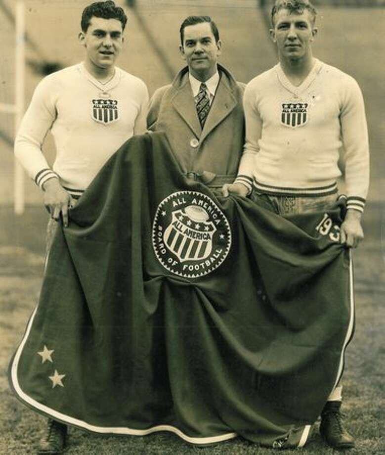 This original photo showing UW football All-American Bill Smith and two others has no caption information. Photo: P-I File