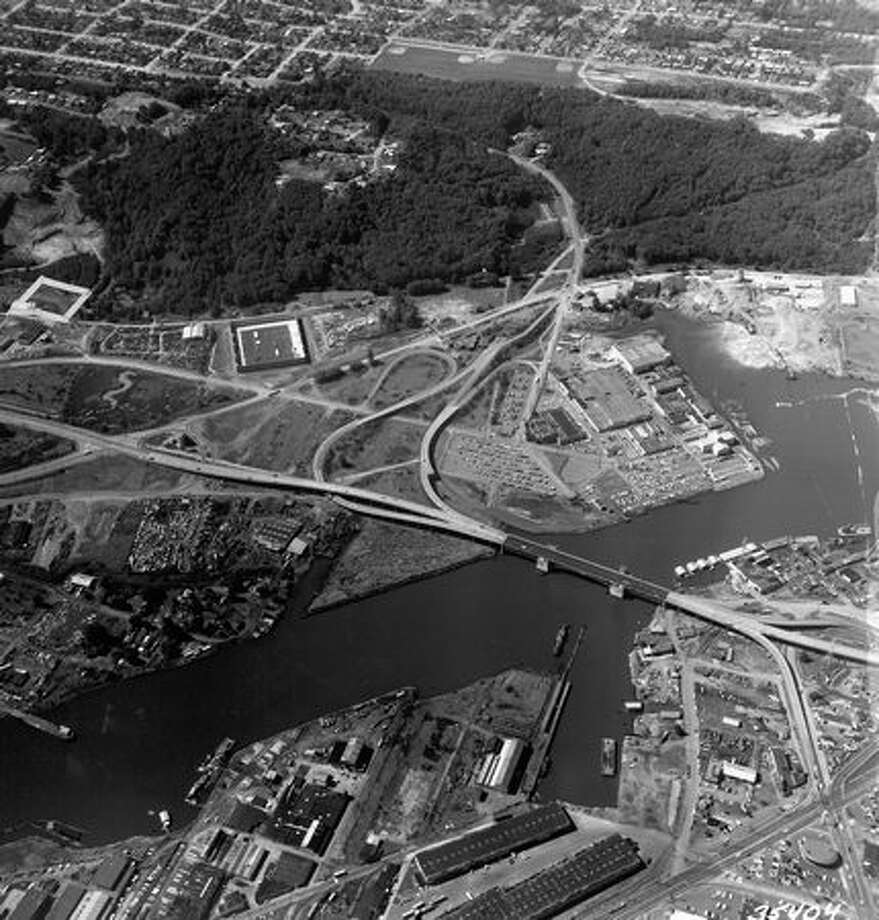 The September 1969 photo caption read: Three acres of industrial-zoned property near the First Ave. S. Bridge have been sold by Joe Managlia to James J. Stein, president of Auto Warehousing Company. Photo: P-I File