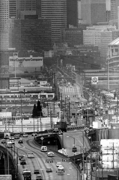 The March 1990 photo caption read: The First Avenue South Bridge is among numerous projects for whic