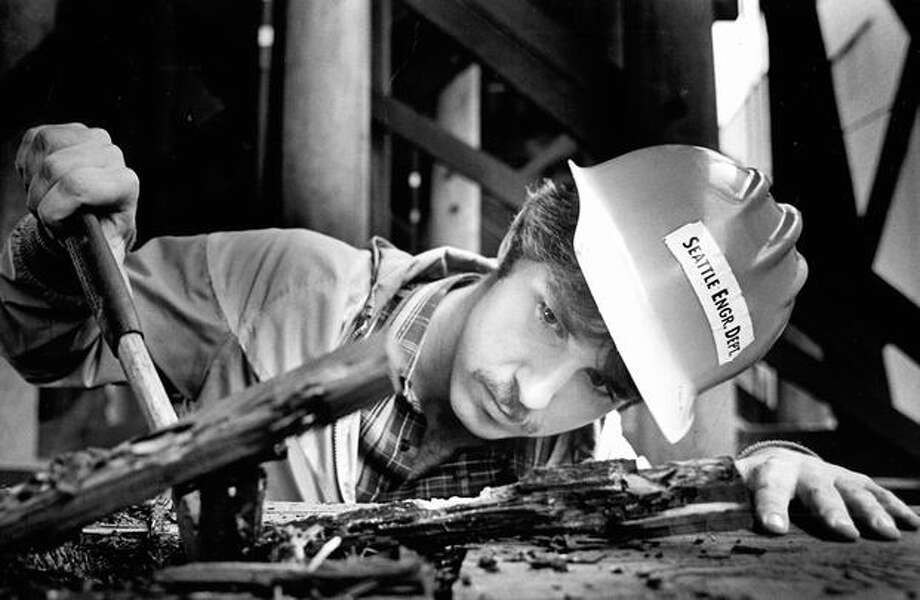 Joe Fletcher of the Seattle Engineering Department inspects for termites on the First Avenue South bridge, Sept. 1, 1983. Photo: P-I File