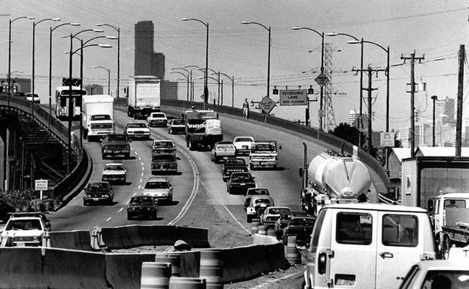 The June 1990 photo caption read: Rush hour traffic funnels onto the First Avenue South Bridge where northbound lanes are reduced to one on weekday afternoons. The bridge has earned the reputation as the second-deadliest stretch of road on the state highway system. Photo: P-I File