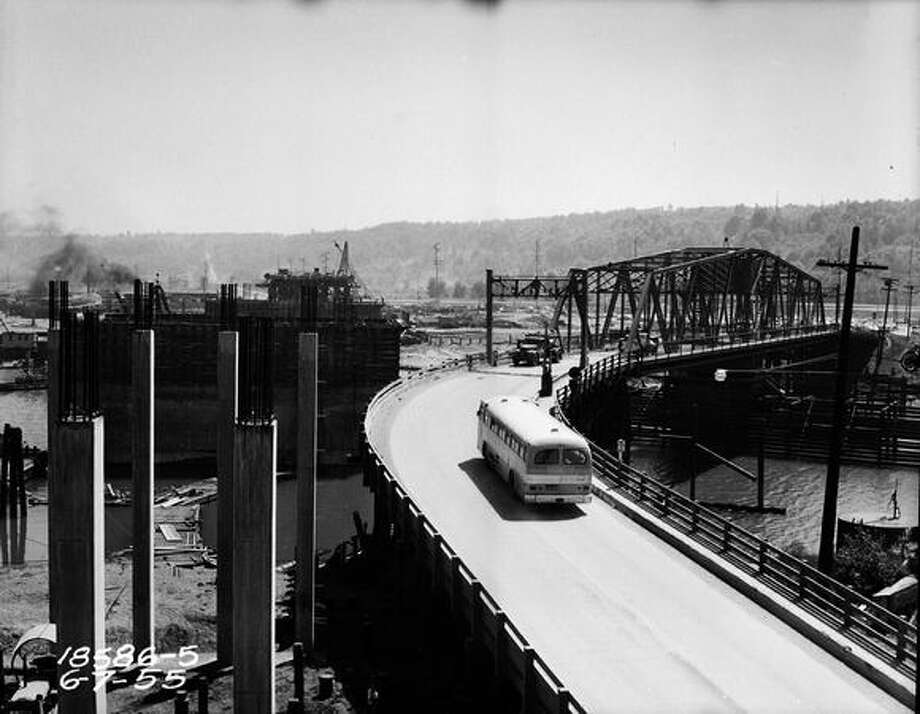 Construction of the First Avenue South Bridge and the old bridge, June 7, 1955. (Seattle Municipal Archives) Photo: P-I File