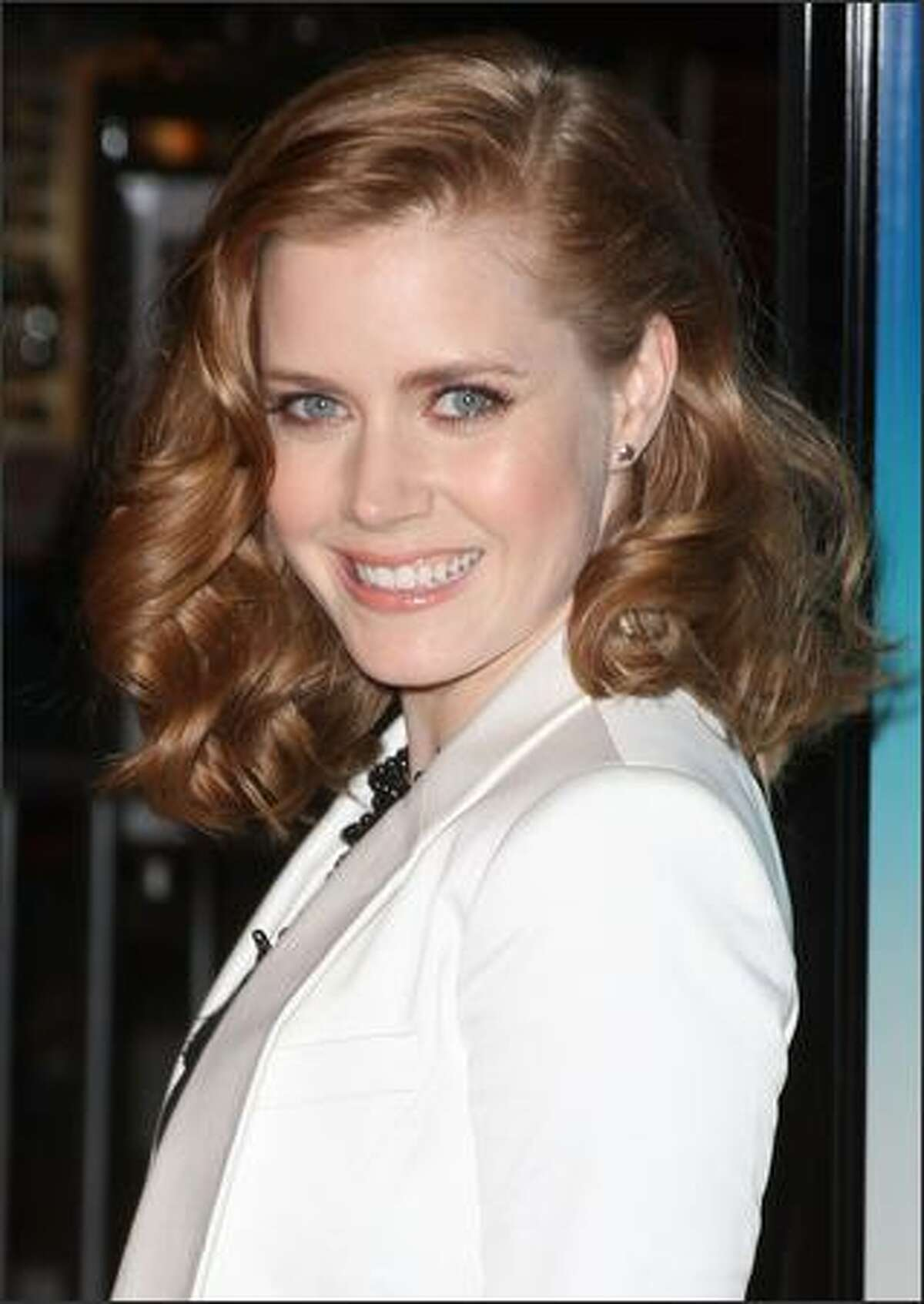 Actress Amy Adams arrives at the Overture Film's screening of 'Sunshine Cleaning' held at Pacific Theaters at The Grove in Los Angeles, California.