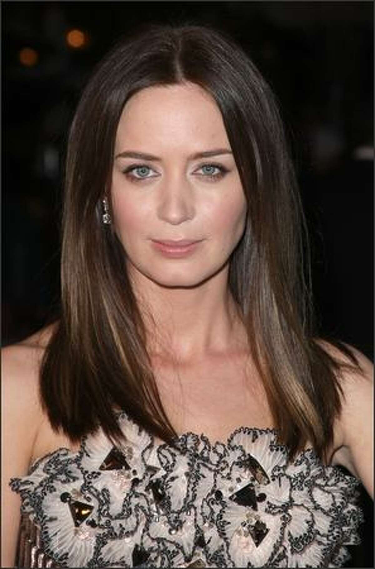 Actress Emily Blunt arrives at the Overture Film's screening of 'Sunshine Cleaning' held at Pacific Theaters at The Grove in Los Angeles, California.