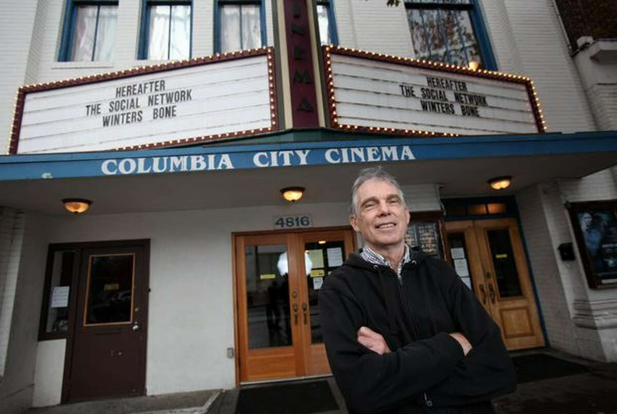 Paul Doyle is photographed in front of the Columbia City Cinema on Thursday, October 28, 2010. The small theater is offering stock to customers to help purchase a new fire sprinkler system. After a recent remodel, City of Seattle officials required the theater to install a fire sprinkler system. Doyle said the system is expensive and is hoping to finance it with the stock offering.