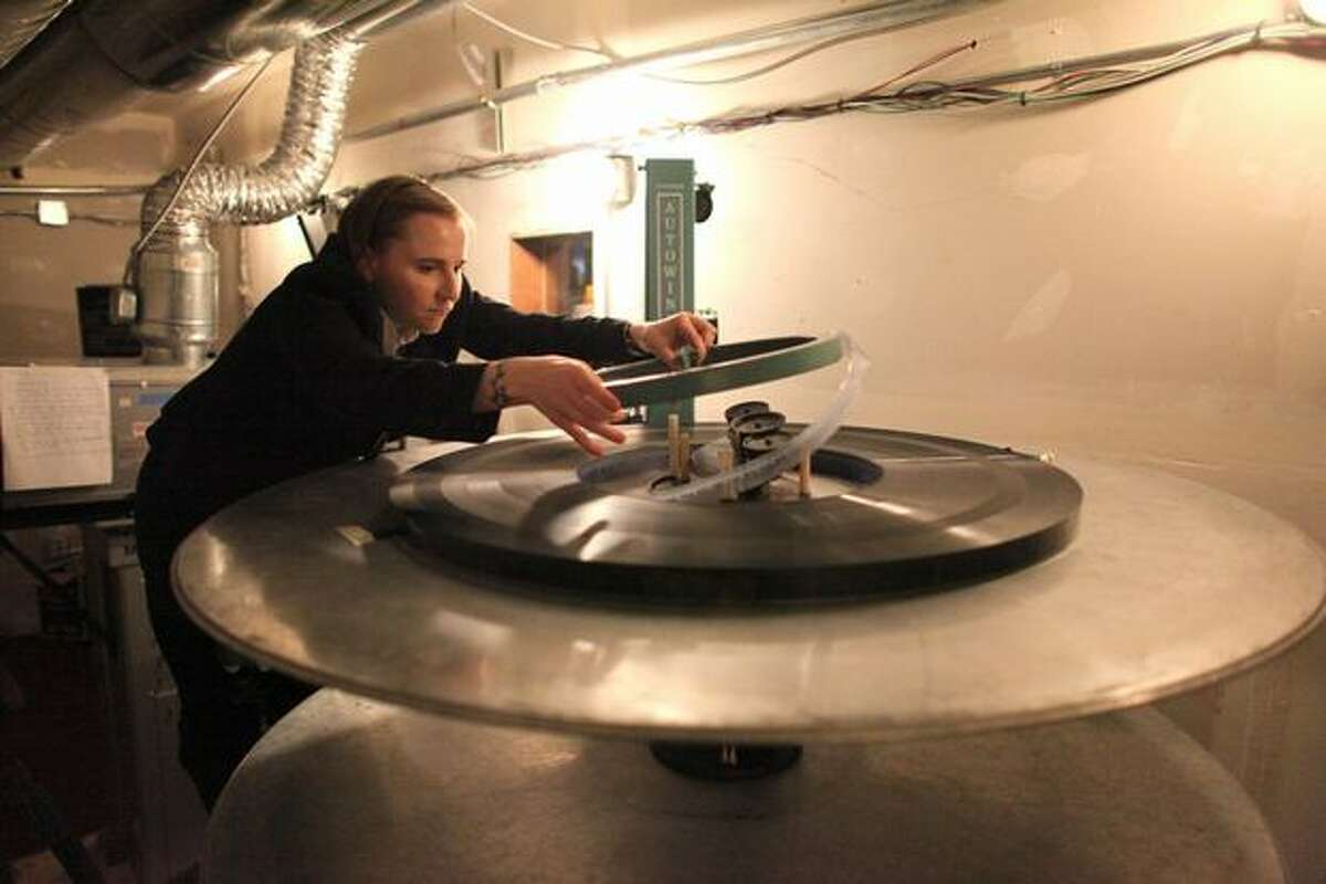 Projectionist Nora Weideman loads