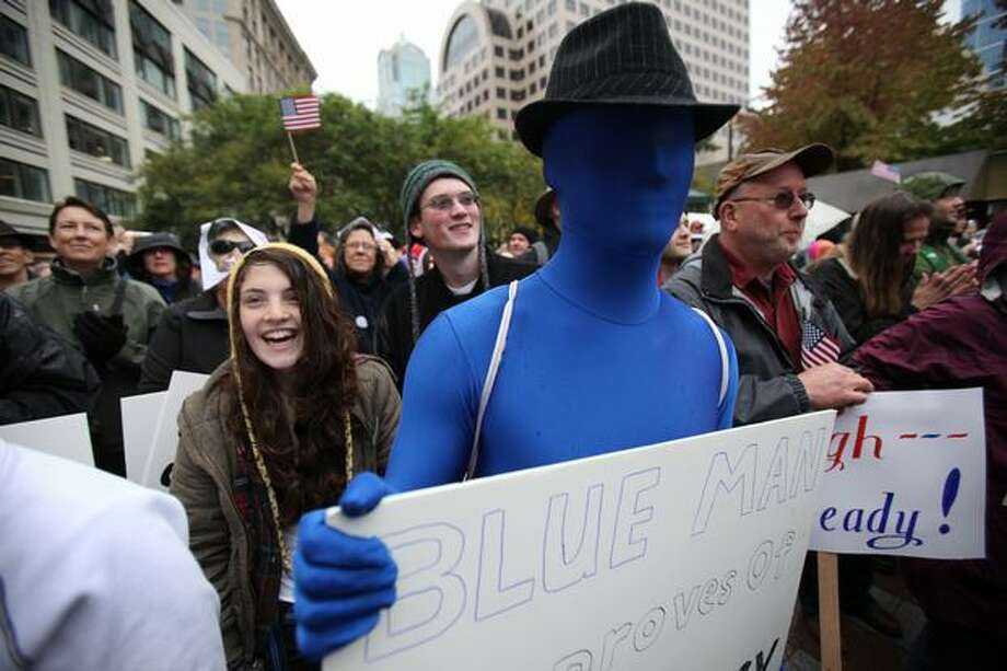 Ben Hansen, dressed as a blue man, participates in the Rally to Restore Sanity at Westlake Park in Seattle. Photo: Joshua Trujillo, Seattlepi.com