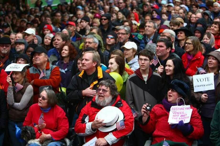 Thousands of people sing the National Anthem at the Rally To Restore Sanity on Saturday, October 30, 2010 at Westlake Park in Seattle. The Seattle satellite gathering is reported to have been the largest of the satellite events, where people listened to speakers and watched the live broadcast of the Rally To Restore Sanity on the National Mall in Washington D.C. Photo: Joshua Trujillo, Seattlepi.com