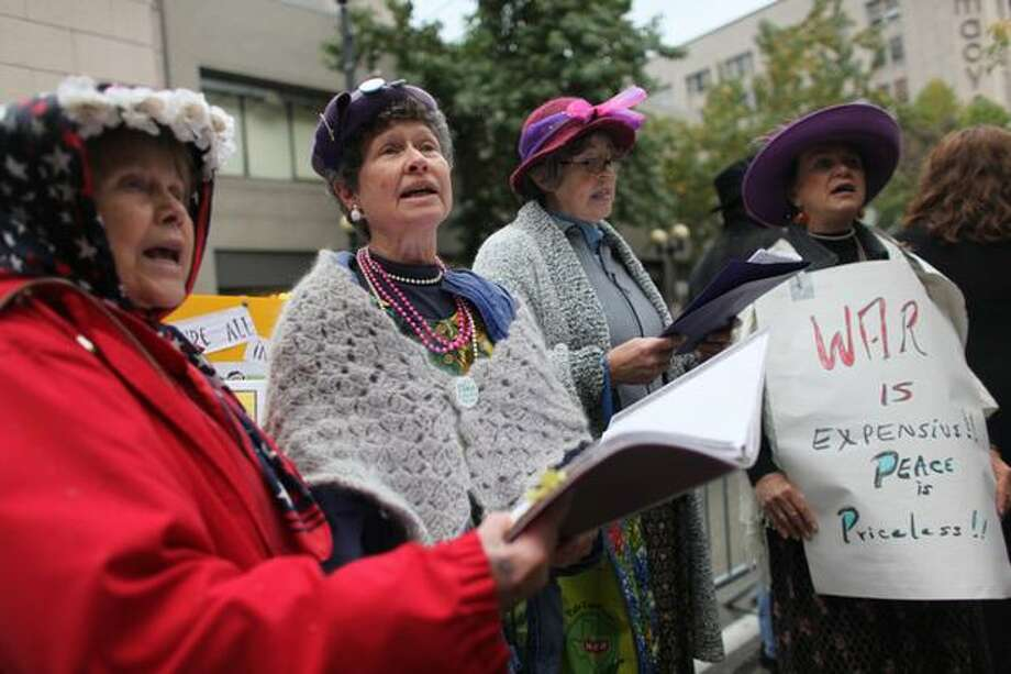 Port Townsend Raging Grannies, from left, Audrey Fain, Diane Bommer, Margie Thomason and Gail Jenkins, sing at the Rally To Restore Sanity on Saturday. Photo: Joshua Trujillo, Seattlepi.com