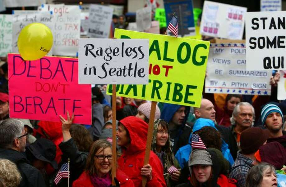 People wave signs at the Rally To Restore Sanity in Seattle. Photo: Joshua Trujillo, Seattlepi.com