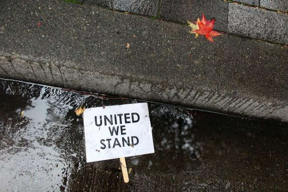 A discarded sign sits in the gutter after the Rally To Restore Sanity concluded at Westlake Park in Seattle. Photo: Joshua Trujillo, Seattlepi.com