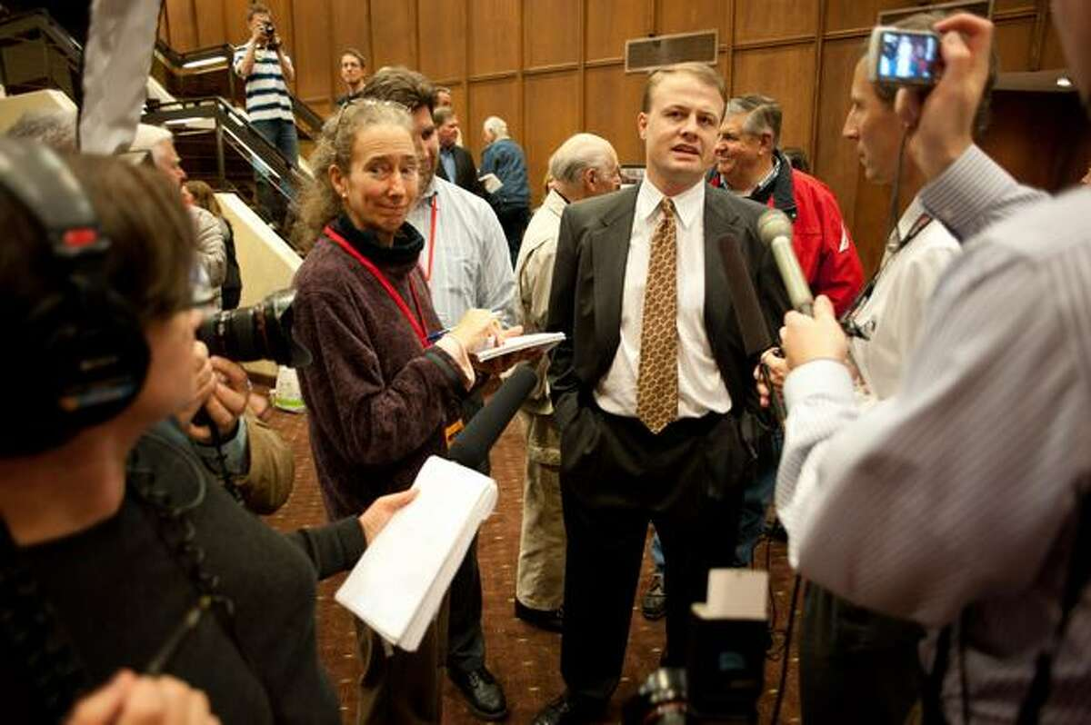 Tim Eyman speaks to reporters during the Washington State Republican Party Celebration at the Hilton Hotel in Bellevue.