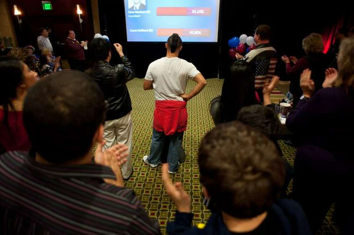 Republicans watch the screen as results come in for the November 2nd midterm elections. The celebration was held at the Hilton in Bellevue.