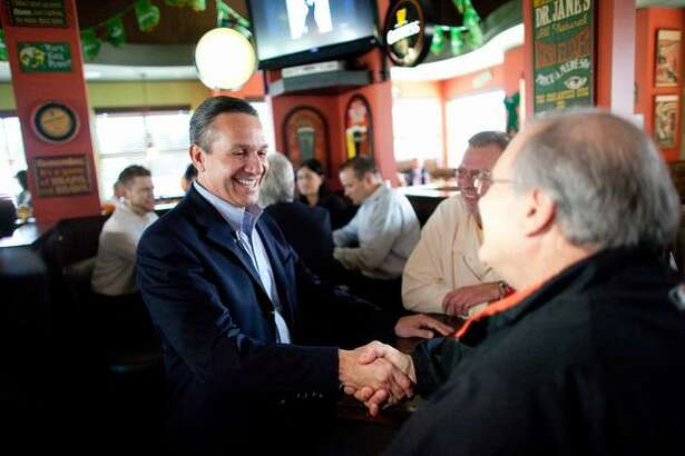 Candidate for U.S. Senate, Dino Rossi, greets diners at Shawn O'Donnell's Restaurant in Everett. Rossi is in a close race with Democratic incumbent Patty Murray.