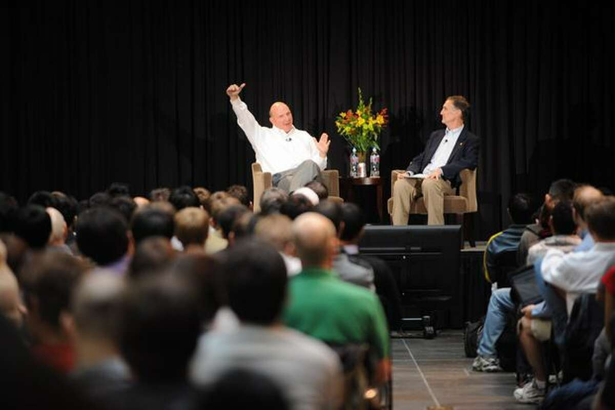 Microsoft CEO Steve Ballmer gestures as he answers questions during a