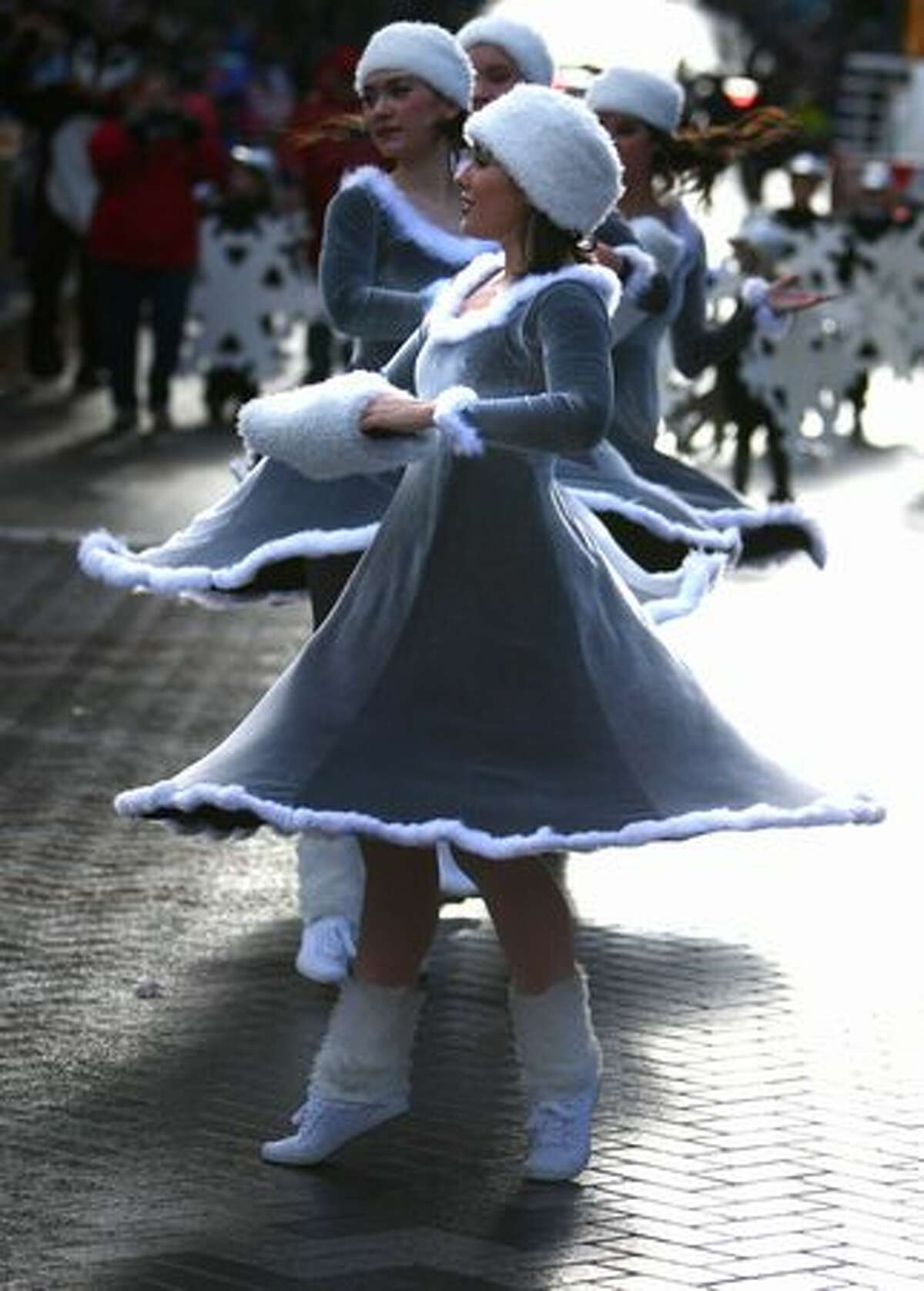 Dancers twirl during the Macy's Holiday Parade in downtown Seattle on Friday. Thousands came out for the annual event early Friday morning.