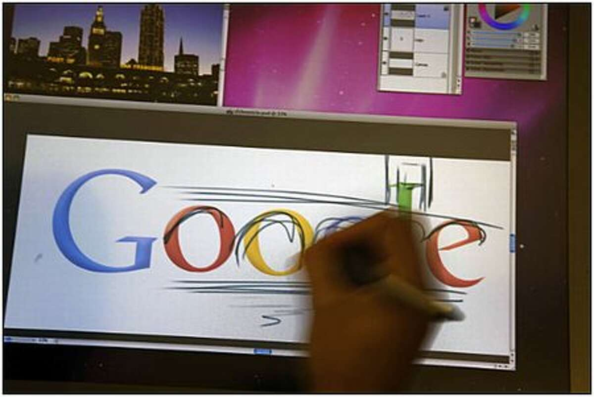 Google Chief Doodler Michael Lopez demonstrates the process of creating a doodle at Google's headquarters in Mountain View, Calif.