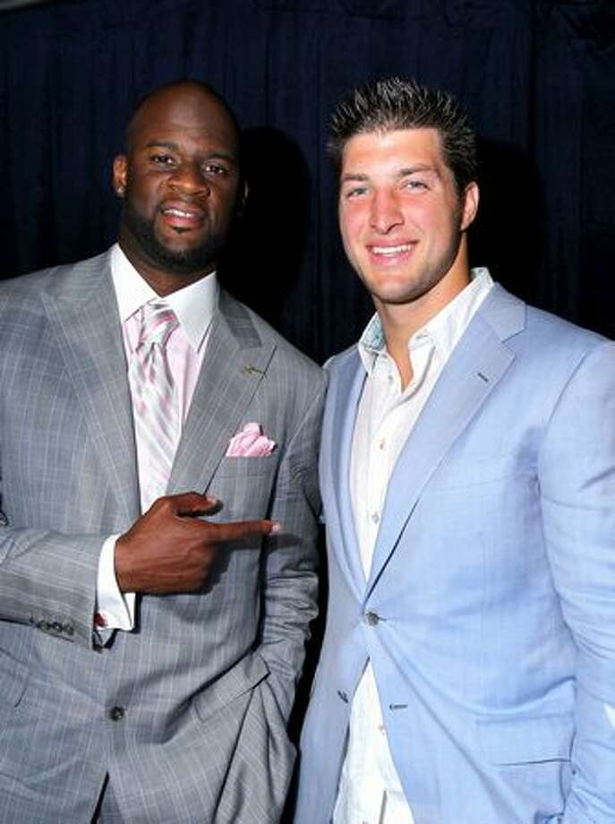 Tennessee Titans quarterback Vince Young and Denver Broncos quarterback Tim Tebow. Photo: Getty Images