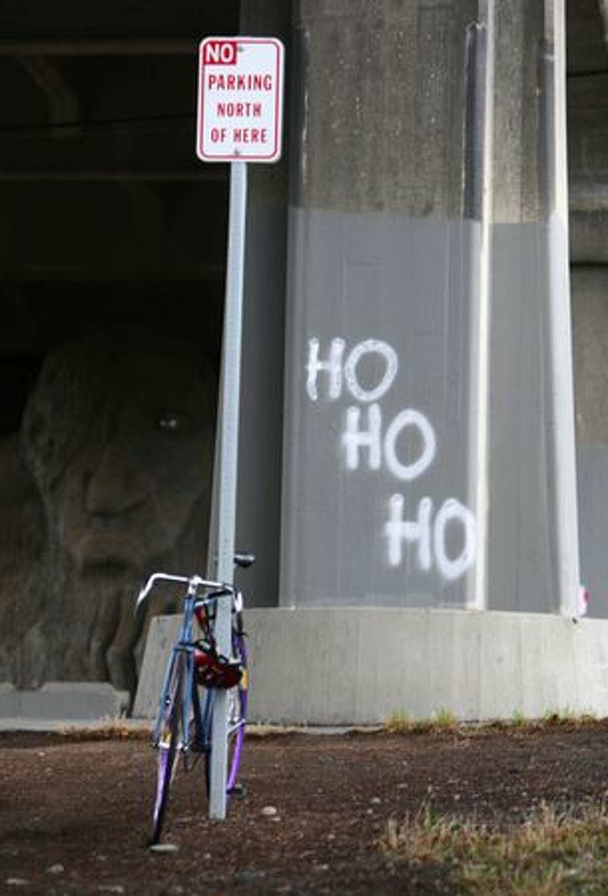 Graffiti - applied with easily removable spray snow - is shown on a support column under the Aurora Bridge during SantaCon.
