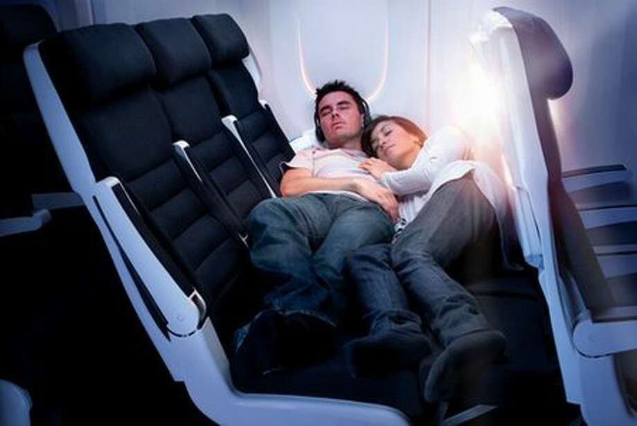 "In January, Air New Zealand announced plans to create an economy-class ""Skycouch."" The idea is that two passengers could buy the third seat in their row and fold out the couch. Economy class has largely remained as cramped as ever in recent years, while business and first class enjoyed increasingly luxury. The Skycouch and other measures, such as ""premium economy"" seats offering a little more room, are intended to give economy passengers a less-spendy way to be a little more comfortable.  Air New Zealand took delivery of the first Skycouch 777 in December. Here's a post with video. (Air New Zealand photo)"