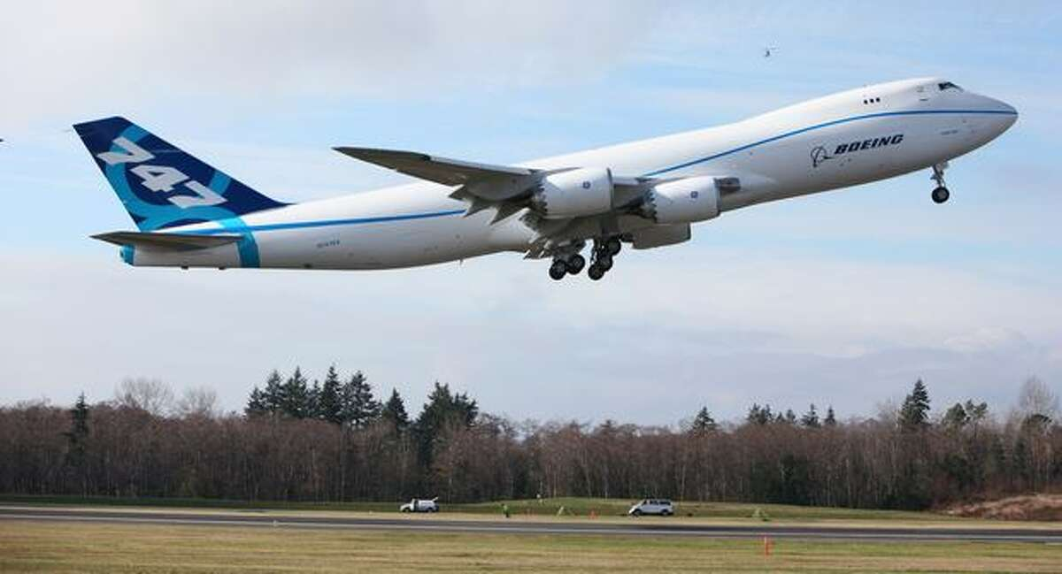 Boeing's first 747-8 Freighter made its maiden flight on Feb. 8, from Paine Field, in Everett, Wash. The stretched 747 has new wings and engines, is more than 18 feet longer than the 747-400 and can carry 30 more tons of cargo (154 tons altogether). Boeing initially planned to deliver the first 747-8 Freighter by the end of 2010, but pushed that to the middle of 2011 in September, citing issues discovered in flight test -- including a low-frequency vibration in certain flight conditions and an underperforming aileron actuator.
