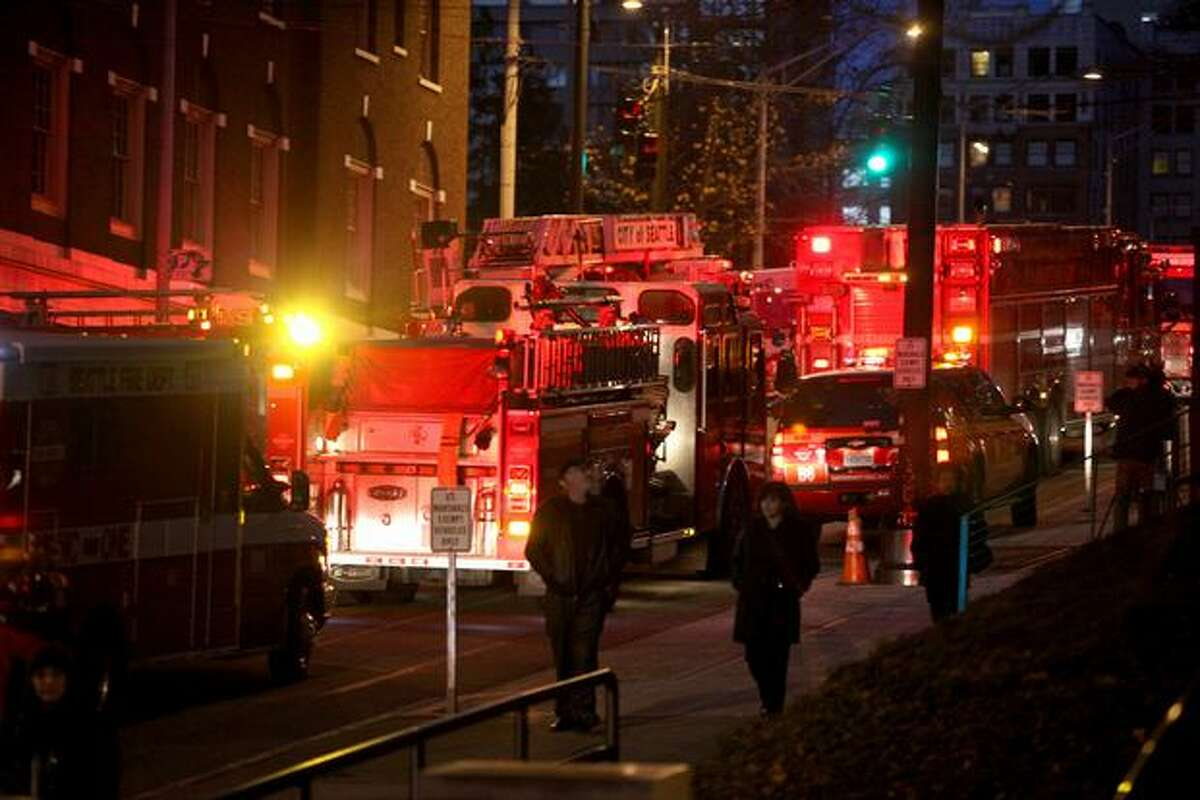 Firetrucks litter the street outside the Holiday Inn Crowne Plaza in downtown Seattle Friday evening Dec. 31, 2010, where a fire broke out. There were no reports of injuries.
