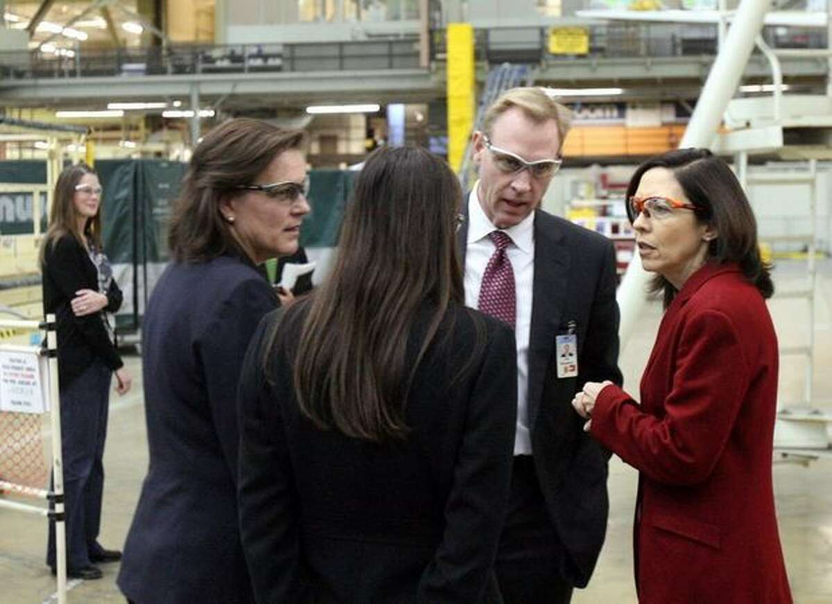 U.S. Sen. Maria Cantwell, D-Wash., (right) talks with Boeing executives after a tour of the company's 767 assembly line in Everett, Wash.