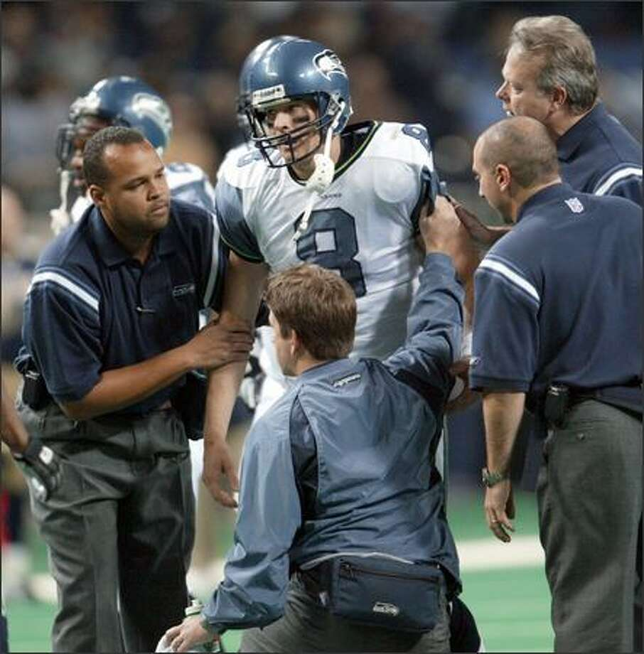 Matt Hasselbeck needed help getting to his feet after getting hit on the team's final drive. The Seahawks quarterback was 21-for-37 passing for 246 yards with one TD. Photo: Scott Eklund, Seattle Post-Intelligencer