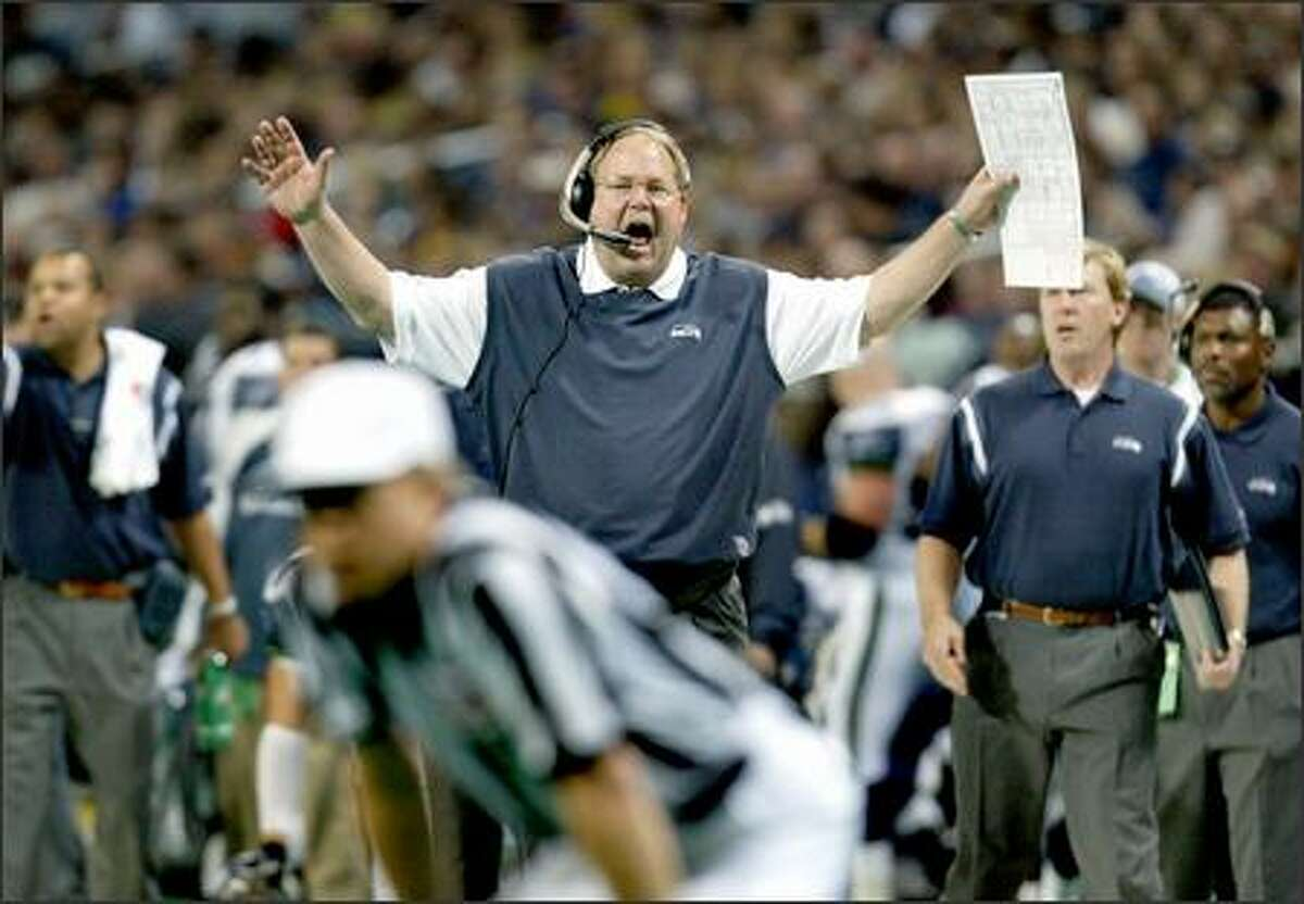 Seahawks coach Mike Holmgren hollers at a referee after receiver Darrell Jackson was flagged for a 15-yard unsportsmanlike conduct penalty when he spiked the ball after scoring a touchdown. Seattle had nine penalties for 64 yards.