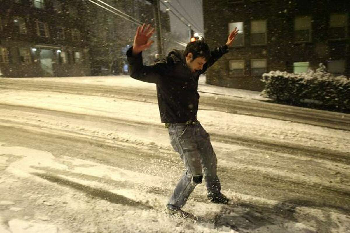 A man slides down the street in Seattle's Capitol Hill neighborhood.