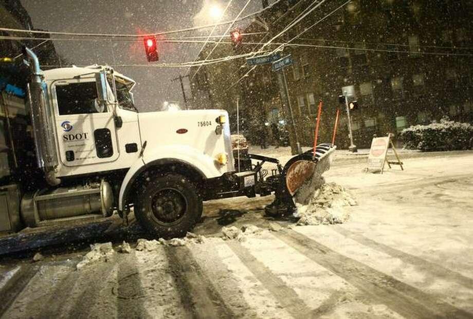 A SDOT plow clears East Denny Way in Seattle's Capitol Hill neighborhood. Photo: Joshua Trujillo, Seattlepi.com