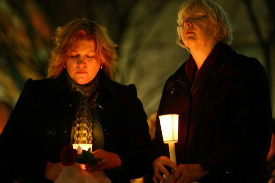 Kelly Picasso, left, and Seattle City Councilwoman Sally Bagshaw pray during a memorial for victims of the recent Tucson shootings. Picasso's grandfather, Dorwan Stoddard, was killed during the rampage. Photo: Joshua Trujillo, Seattlepi.com
