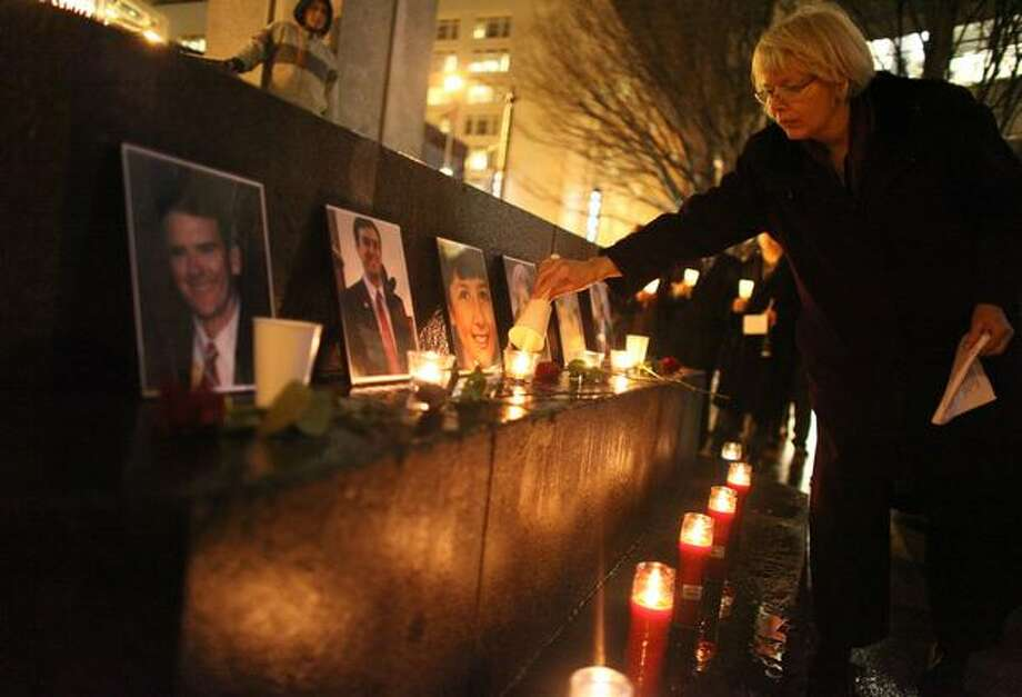 Seattle City Councilwoman Sally Bagshaw lights a candle during a memorial for victims of the recent Tucson shooting. Photo: Joshua Trujillo, Seattlepi.com