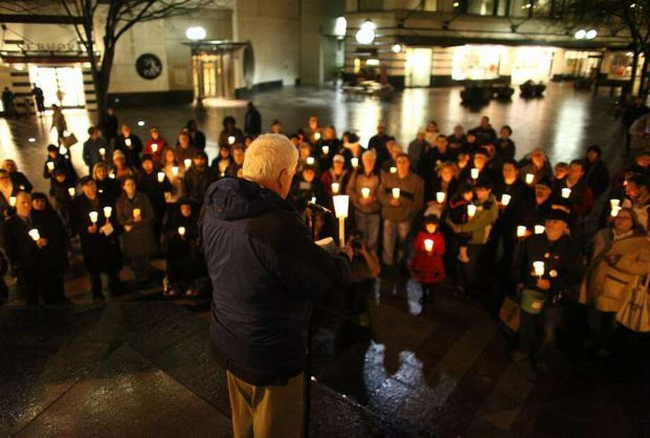 U.S. Rep. Jim McDermott speaks to a crowd during a memorial at Seattle's Westlake Park for victims of the Tucson shooting rampage. The shooting was an assassination attempt of McDermott's colleague, U.S. Rep. Gabrielle Giffords, D-Ariz. Photo: Joshua Trujillo, Seattlepi.com