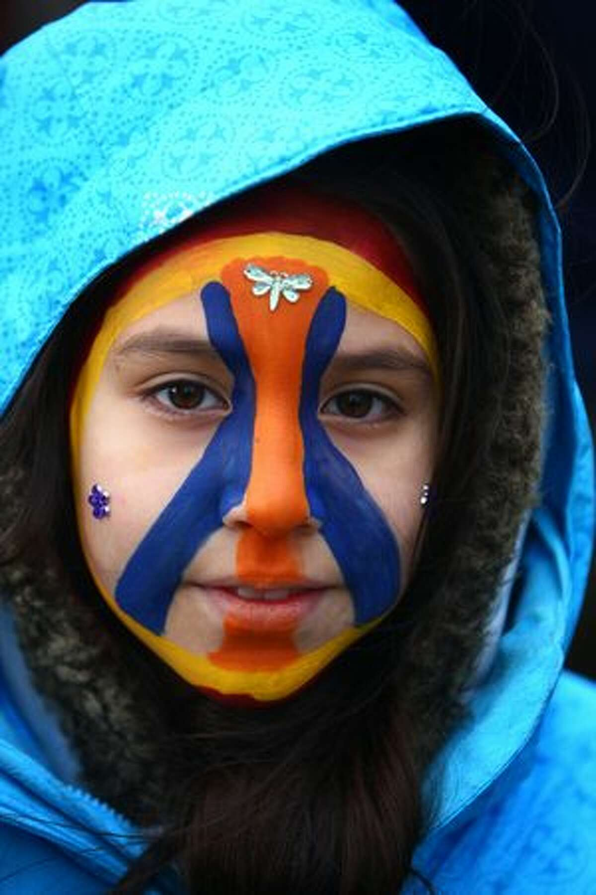 Maya Lazi-Fanning, 10, sports a peace sign on her face during a march and rally on Martin Luther King, Jr. Day.