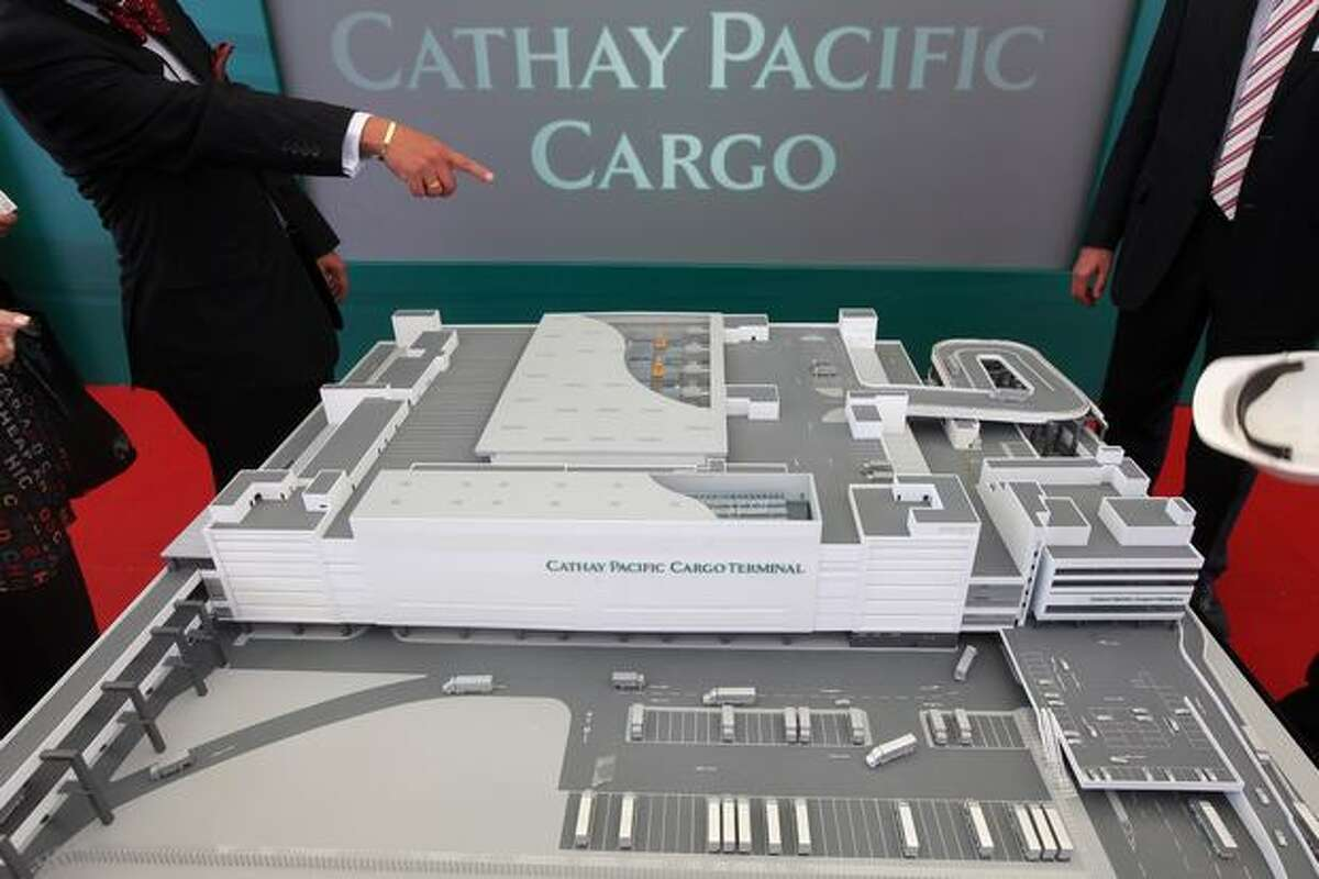 A man points to a model of the new Cathay Pacific cargo terminal at Hong Kong International Airport