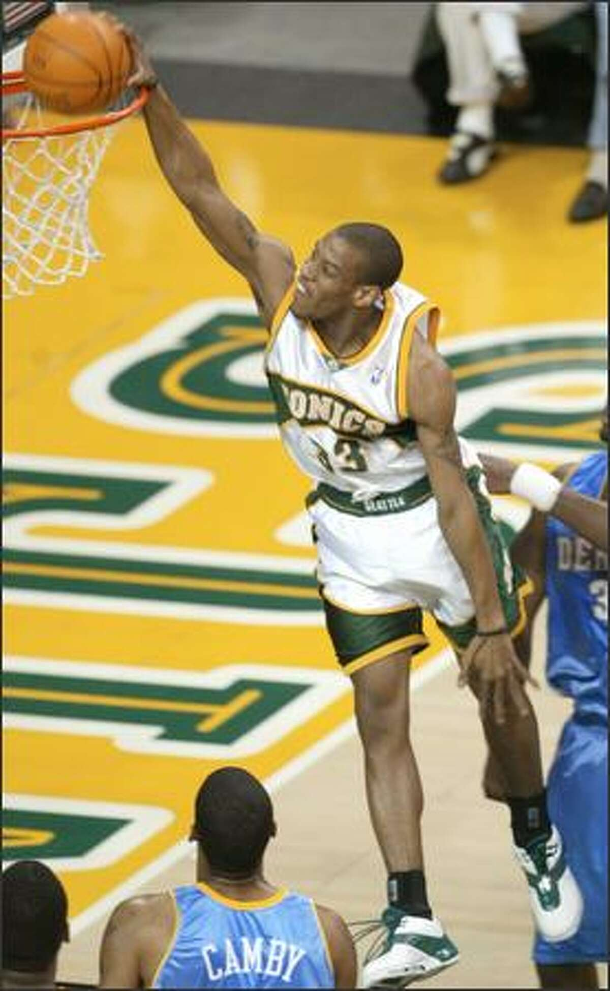 Antonio Daniels drops one through for the Sonics.