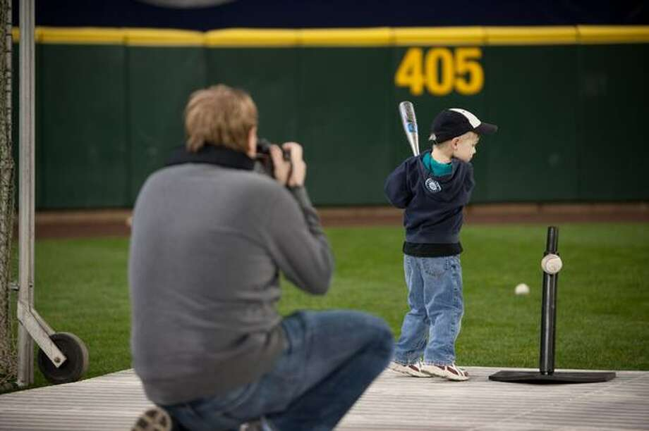 Noah Bissmeyer captures his son's attempts to hit the ball. Photo: Elliot Suhr, Seattlepi.com