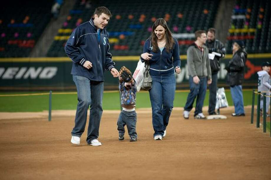 Josh, Ethan and Katie Koontz take a run around the bases. Photo: Elliot Suhr, Seattlepi.com