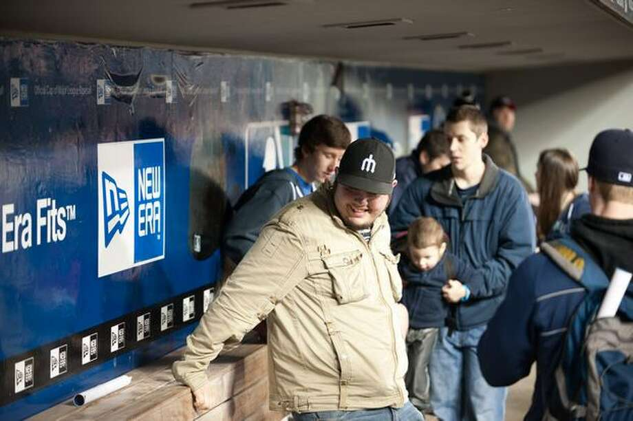 Fans gets a close look at the inside of a dugout. Photo: Elliot Suhr, Seattlepi.com