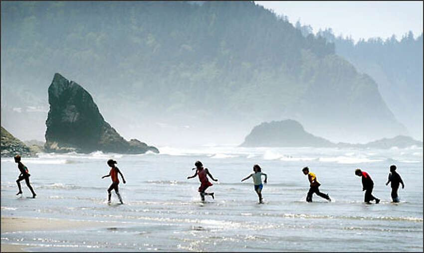 Kids from Portland's Cedarwood School play in the surf at Hug Point State Recreation Area. Access to Oregon's breathtaking beaches is guaranteed to all by state law, and plenty of people are drawn to them.Arias: