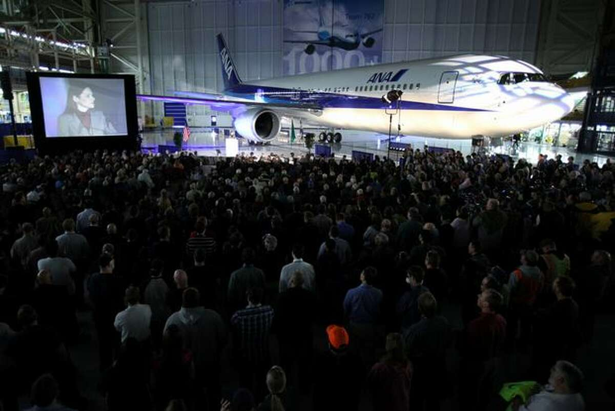 Boeing employees and guests participate in a ceremony celebrating the 1,000th Boeing 767 airplane and relocation of the 767 production line within Boeing's Everett plant.