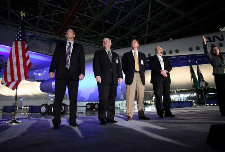 Boeing executives, from left, Kenneth Shirley, Edward Callahan, Darrel Larson and Jerry Deinas watch a presentation during a ceremony celebrating the 1,000th Boeing 767 airplane and relocation of the 767 production line within Boeing's Everett plant. Photo: Joshua Trujillo, Seattlepi.com